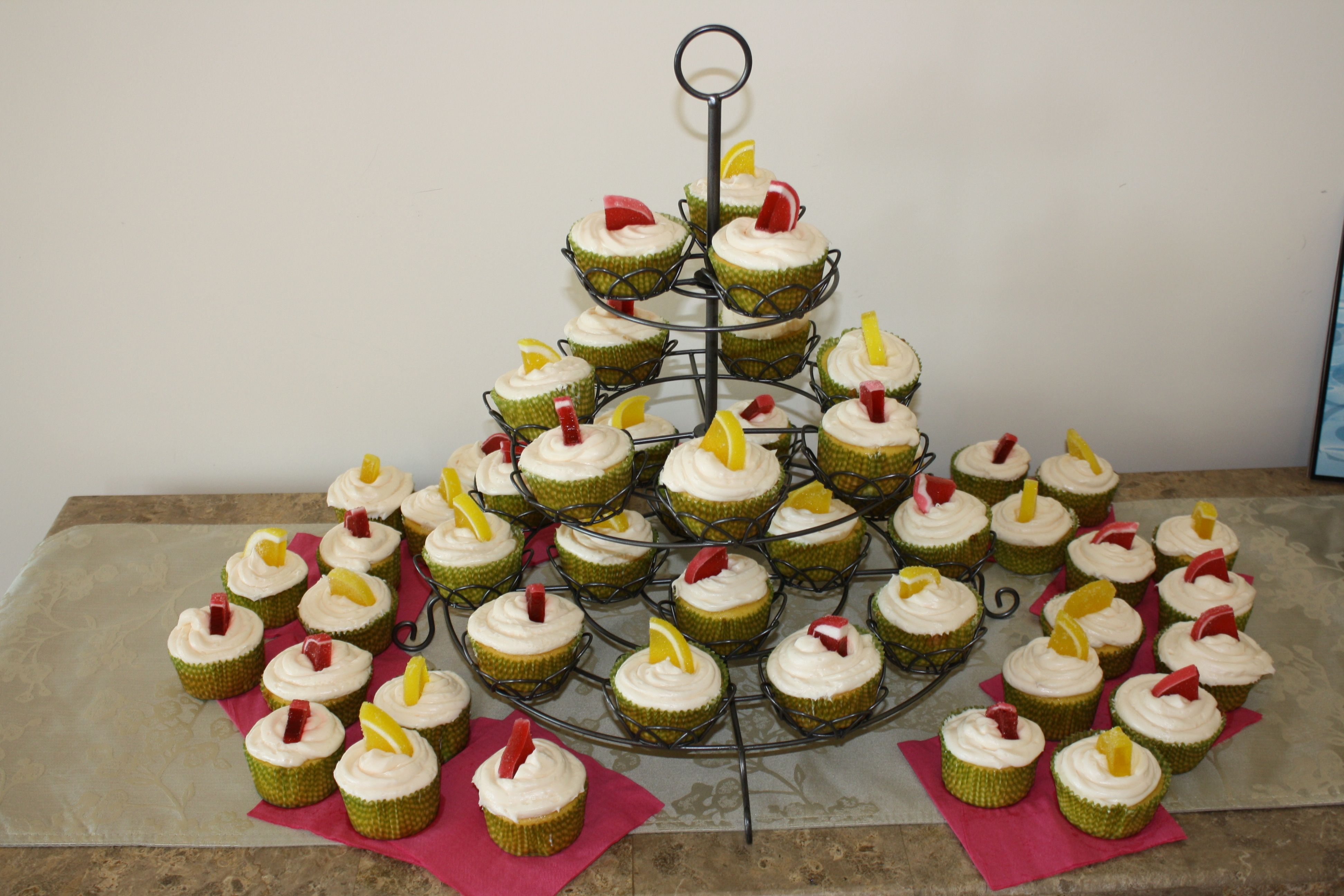 Lemon cupcakes with raspberry jam filling, cream cheese frosting and a sugary lemon or raspberry slice on top!