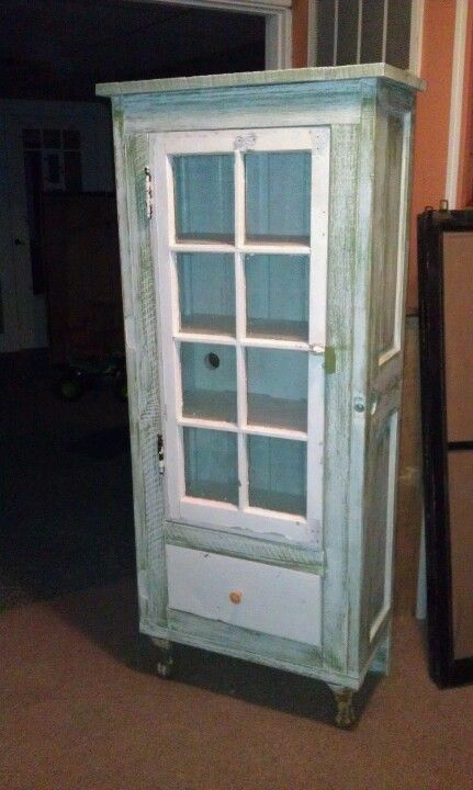 Upcycled doors and window now become a lovely cabinet complete with ...