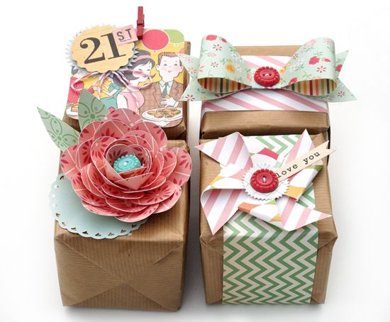 I especially like the pinwheel and hand cut bow using scrapbook paper scraps