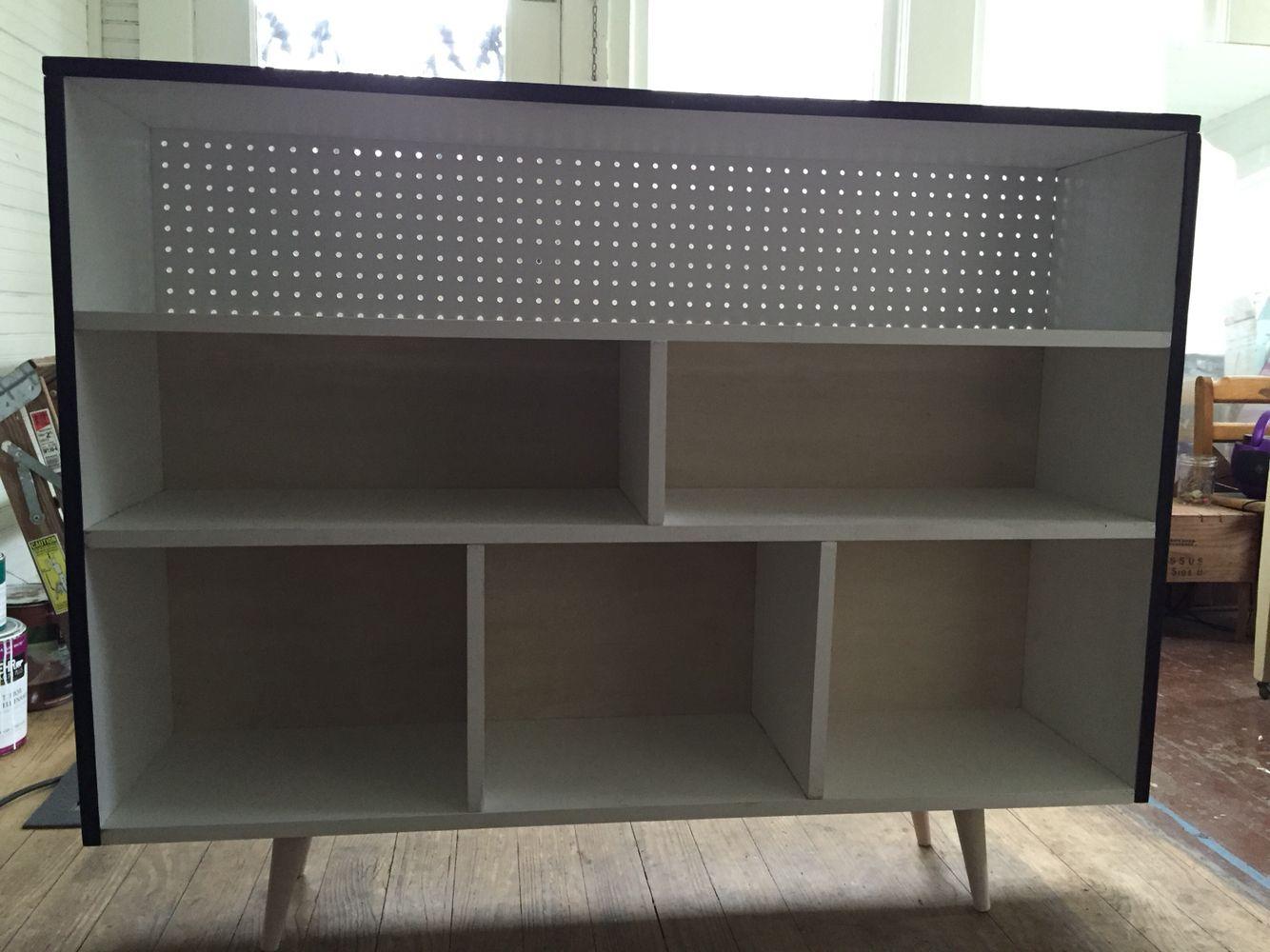 Bookcase Using Peg Board And Whitewashed Plywood Backing.