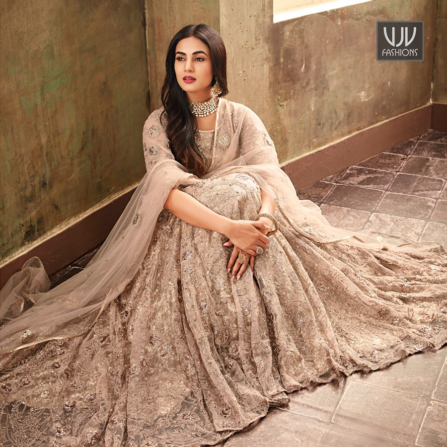 b53faa6ea8d9 Sonal Chauhan Peach Color Net Designer Anarkali Suit Spread the aura of  freshness with this peach