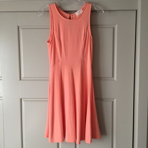 Peach Everly Dress Peach dress with tags! Never been worn! I would recommend wearing a slip under the dress due to the light color. Everly Dresses