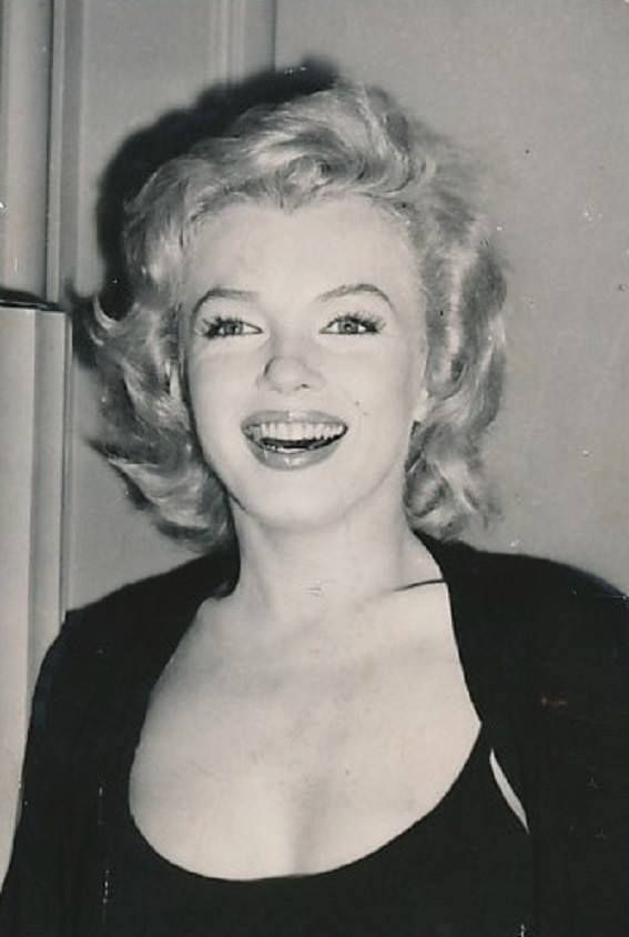Marilyn Monroe as she appeared at a press conference outside her Sutton Place apartment, NYC, where she spoke to reporters about her engagement to Arthur Miller, 1956.