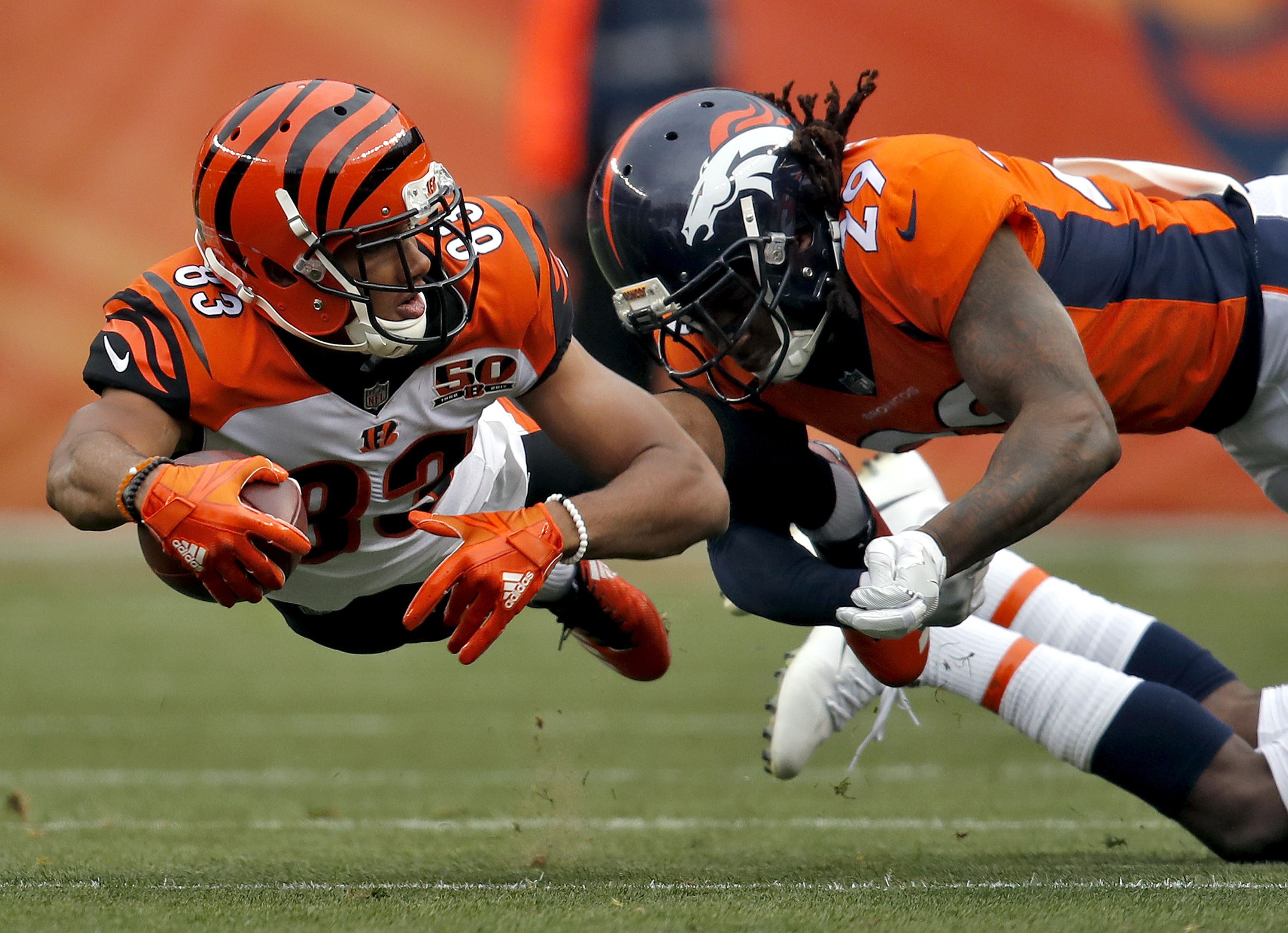Bengals WR Tyler Boyd LAYS OUT for those extra yards. (AP