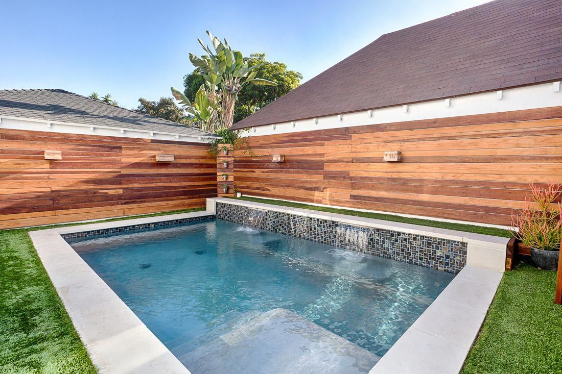 Renovation Of A Spanish Style Home In Silver Lake Featuring Private Horizontal Cedar Wood Fencing Small Pool Design Small Swimming Pools Small Backyard Pools Modern spanish backyard with pool