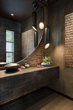 Ambiance luxueuse en brun bronze et noir immense miroir en demi cercle bathroom black for Immense miroir