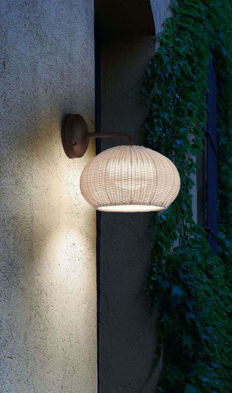 Outdoor wall lamp with frame and canopy made of aluminum that can withstand exposure to the elements. Lamp shade is composed of hand wrapped polyethylene synthetic fiber, available in different colors