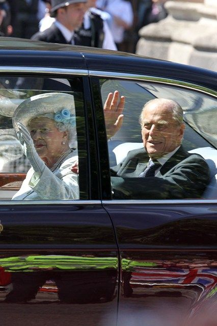 JUNE 4 - The Queen and Prince Philip wave to the crowds as they arrive at Westminster Abbey for a service to commemorate 60 years since Her Majesty's coronation.