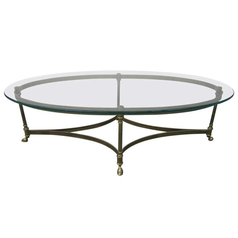 Brass heavy glass oval hoof foot coffee table regency for Contemporary oval coffee tables