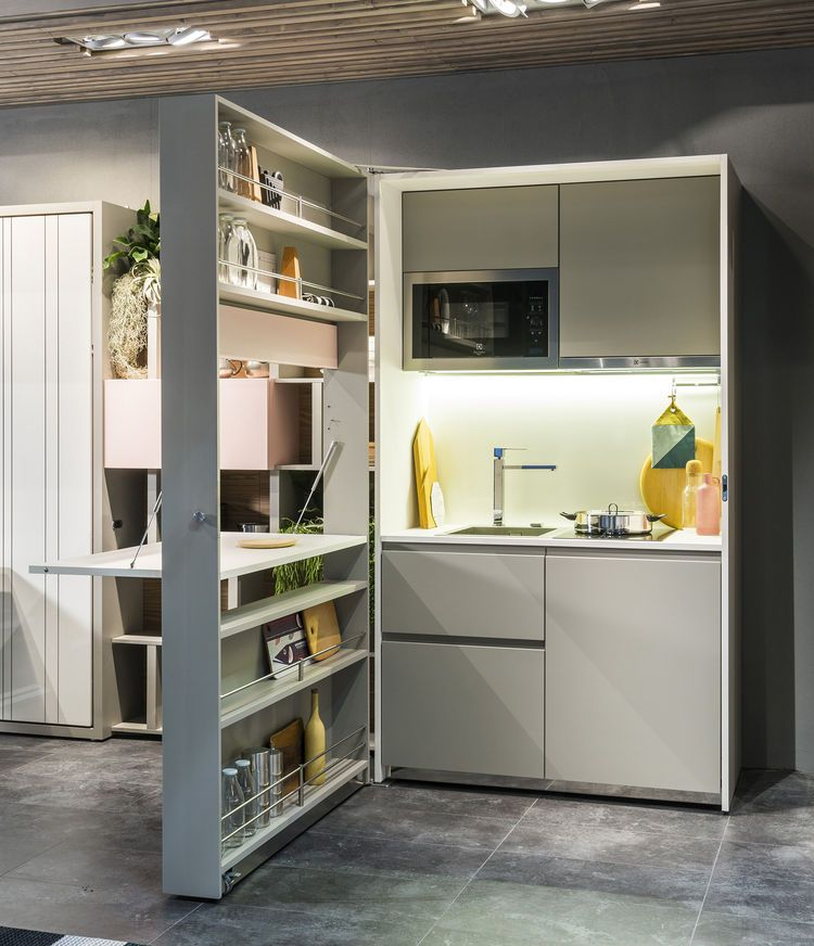 Discover the best genius-unfolding-kitchen-tucks-neatly-small-spaces on Dwell