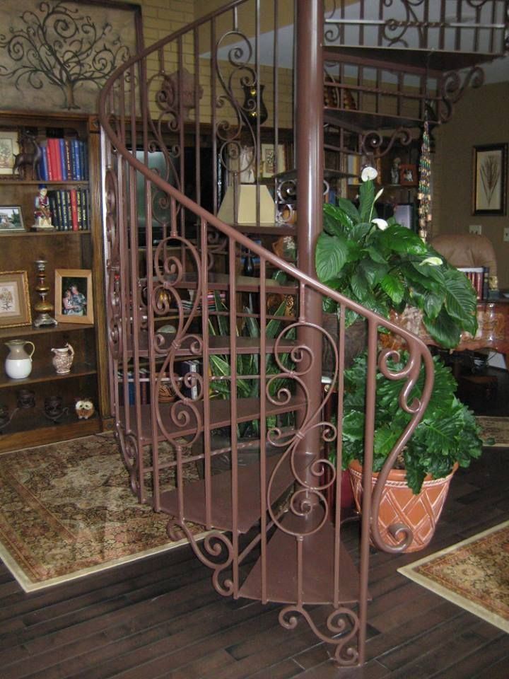 indoor spiral staircase with scroll work by Appalachian Ironworks in Virginia www.appalachianironworks.com