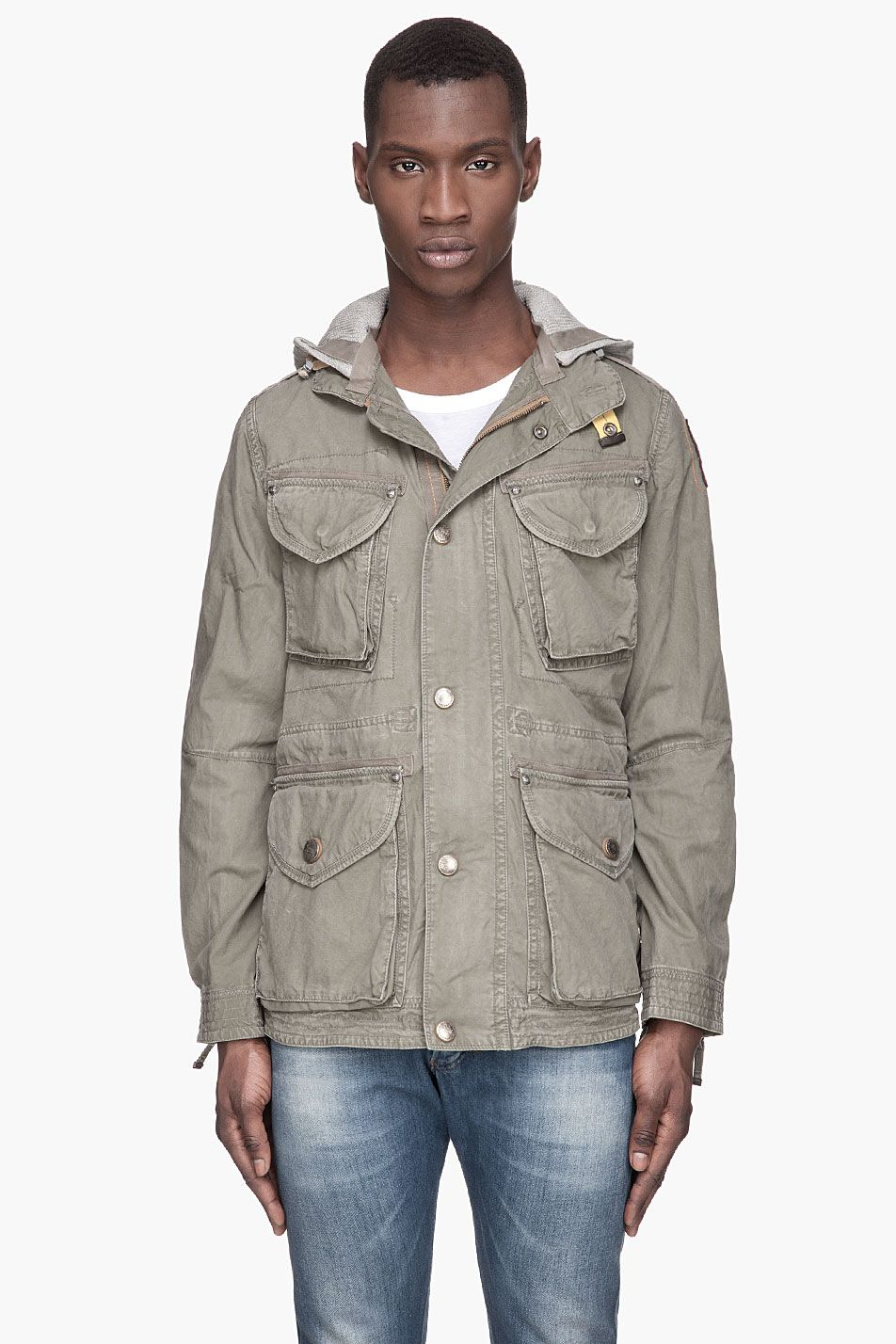 Parajumpers Khaki Green Randolph Hooded Jacket -  Parajumpers Khaki Green Randolph Hooded Jacket Parajumpers Long sleeve cargo jacket in khaki green. Fading. tonal accent stitching. and orange accent stitching throughout. Stand collar with press_stud closure on yellow tab. Heather grey jersey hood lined in tonal waffle cotton. Secondary...