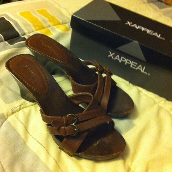 Brown buckle sandals Very stylish brown sandals. Worn only twice but they weren't as comfortable as I wished they were and they were a bit too small. They have either a 2.5 in heel or a 3 in heel. x-appeal Shoes Sandals