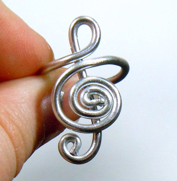 Treble Clef Adjustable Aluminum Ring by melissawoods on Etsy, $6.00---the kind of ring i might actually wear