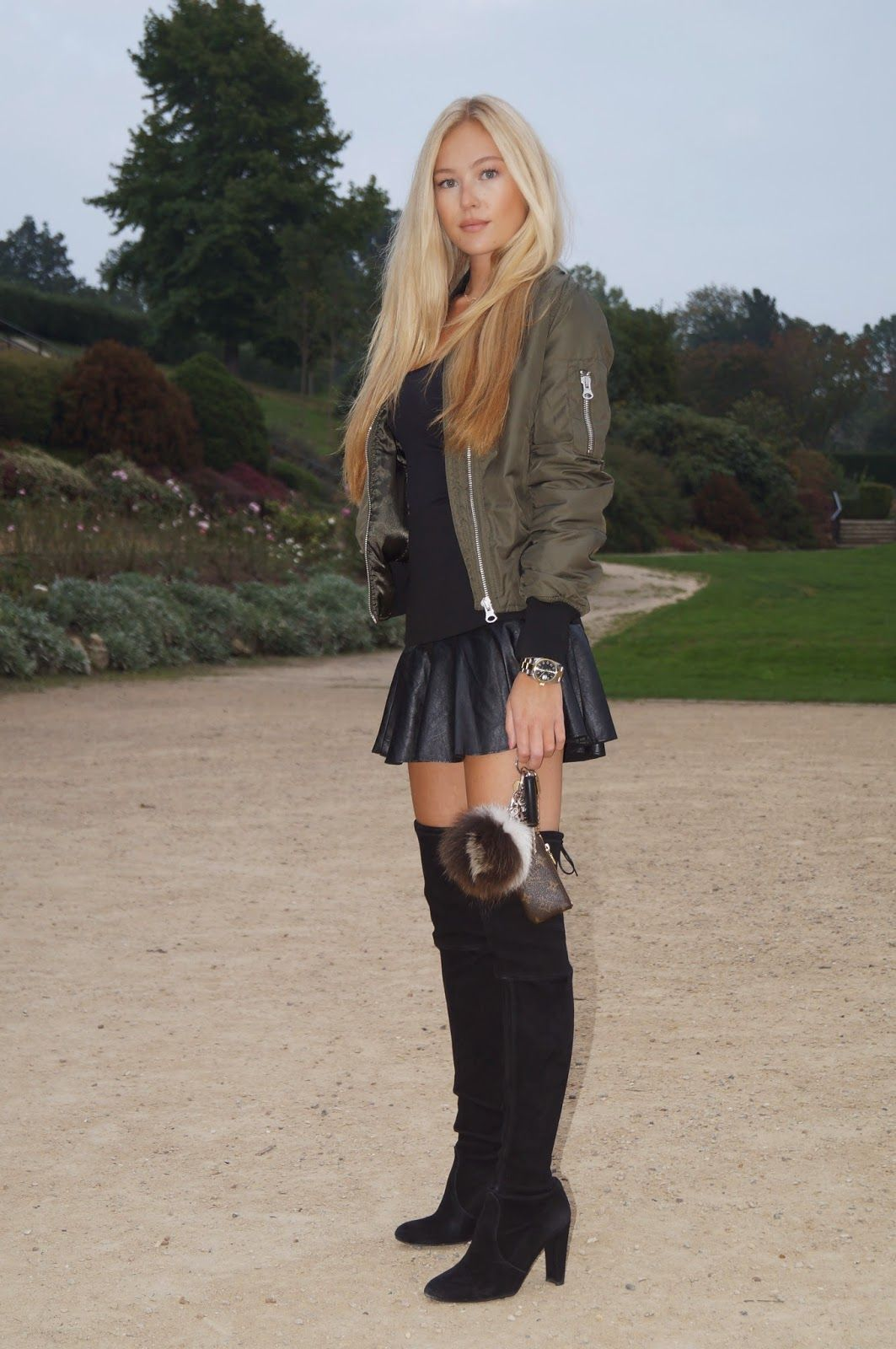 Sexy girl in leather skirt