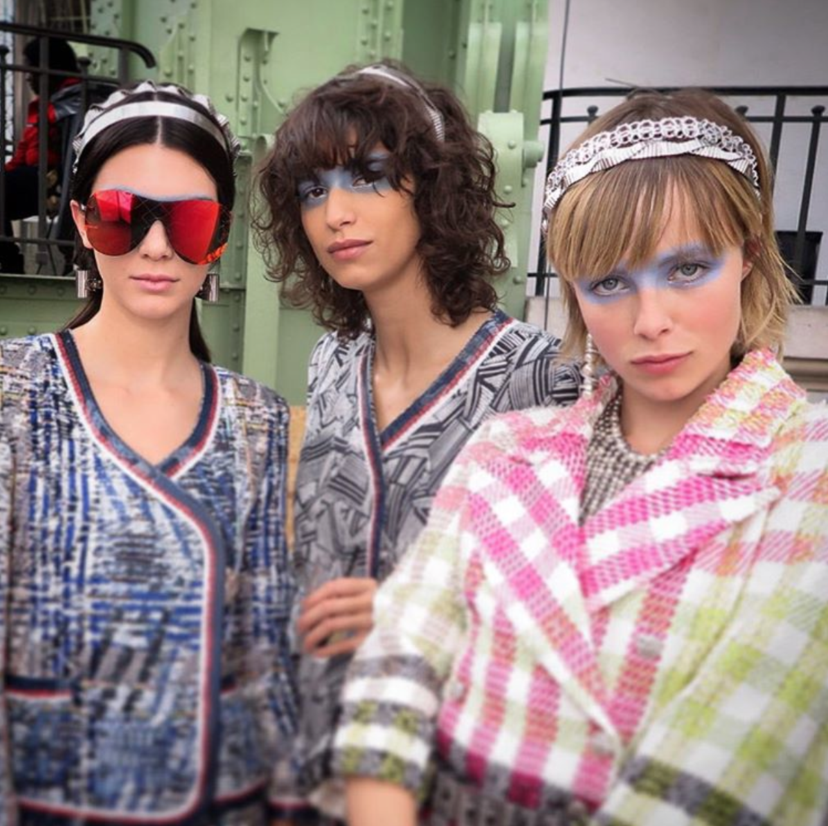 October 6, 2015- Kendall Jenner, Mica Arganaraz, and Edie Campbell backstage at Chanel