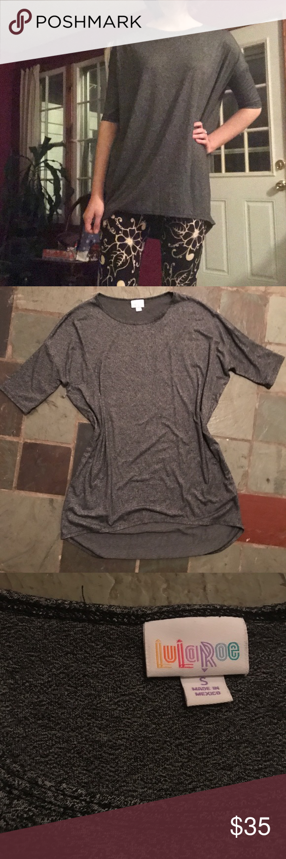 """Dark grey lularoe irma tunic top size small Dark grey heather black lularoe irma top. It has a hi-low cut, and is super stretchy and comfortable! Fitted arms with a flowy loose style. No flaws that I can find, it's in great condition! Feel free to make offers no trades or """"lowest price?"""" Thanks! ~leggings pictured are also for sale!~ LuLaRoe Tops Tunics"""