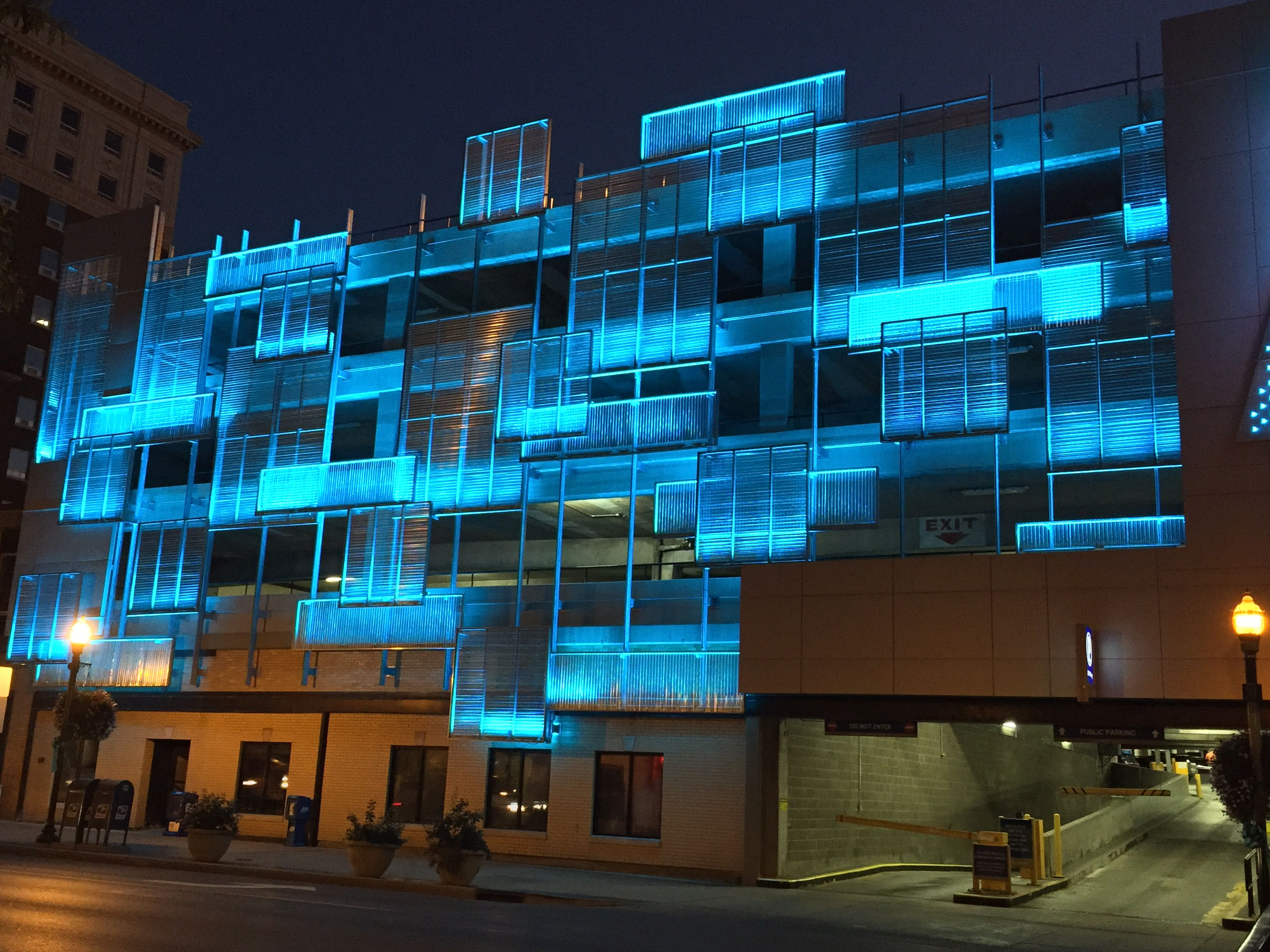 Unique Lighting Design On The Outside Of A Parking Garage In