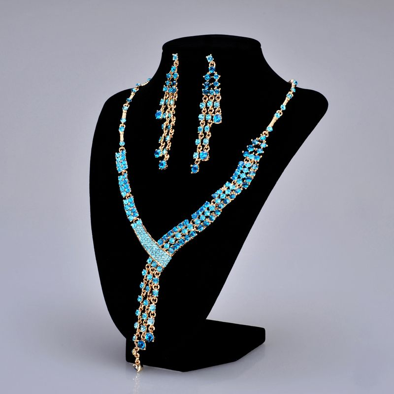 Asymmetrical Golden Alloy Earrings and Necklace Set with Lake Blue Rhinestones Category:Jewelry SetsGender:WomenOccasion:Special Occasion/Engagement /AnniversaryMaterial:Alloy/RhinestonesMaterial Color:GoldShown Color:Gold Lake BlueClosure Type:Lobster…