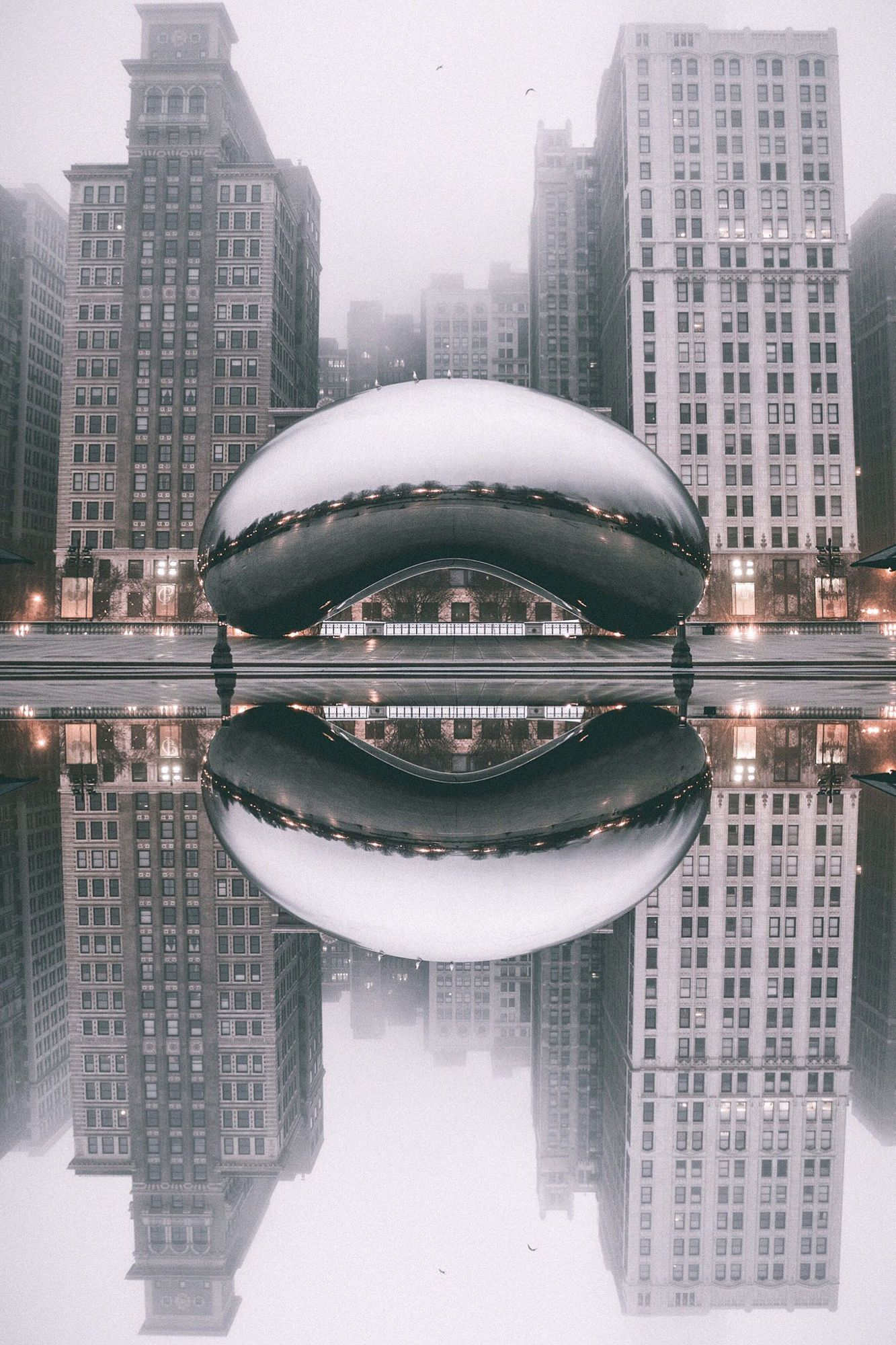 Reflection Chicago's famous sculpture 'Bean' or 'Cloud