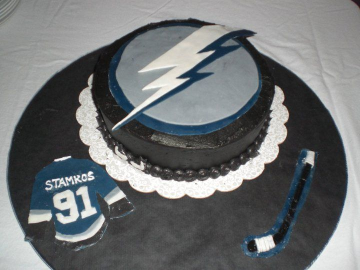 Lightning Hockey Puck Birthday Cake-Lemon Cake with Chocolate Mousse Filling and Lemon Curd Filling with Chocolate Buttercream Frosting