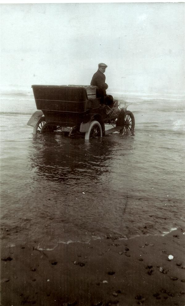 Lovely photography of an old automobile driving in the ocean. I do not really understand this shot and why the man drove into the water. But i love the foggy landscape. #photo #old #vintage #auto #car