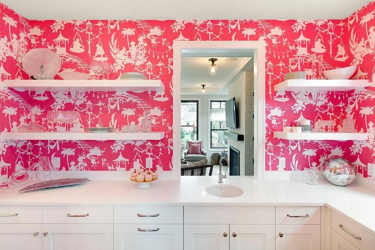 White and pink kitchen features walls clad in pink toile wallpaper ...