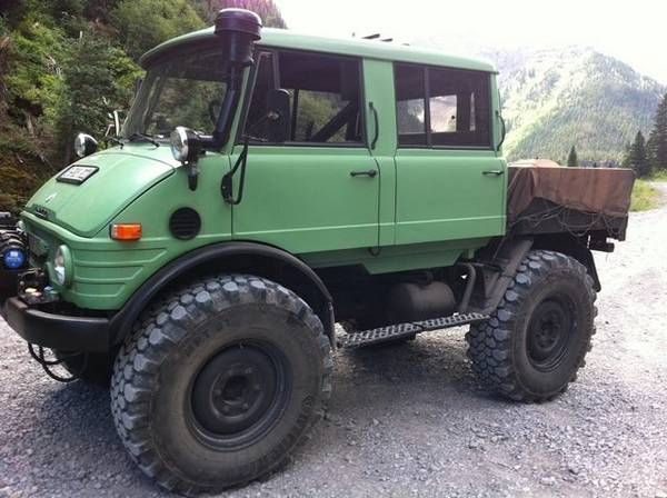 "'75 Mercedes Benz Unimog 406 ... ""said to be one of about 350 torque converter-equipped, double cab or Doka-bodied, aircraft tug ""Flugzeugschlepper"" models. """