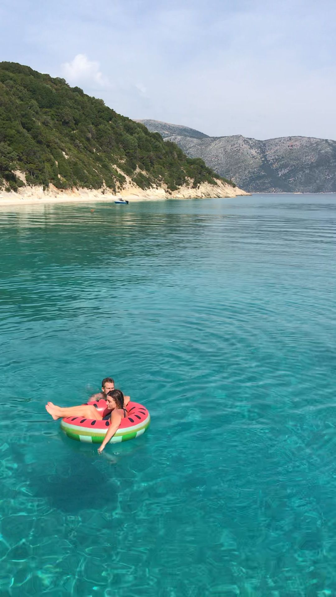 Make sure to do a day trip from Kefalonia to Ithaca to swim in the crystal clear, azure water and float in the sun #ithaca #greekislands #kefalonia#ionianislands#azure#sunbed#swimming