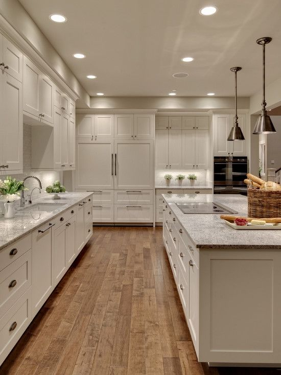 Love the white shaker cabinets with contrasting wood floors.