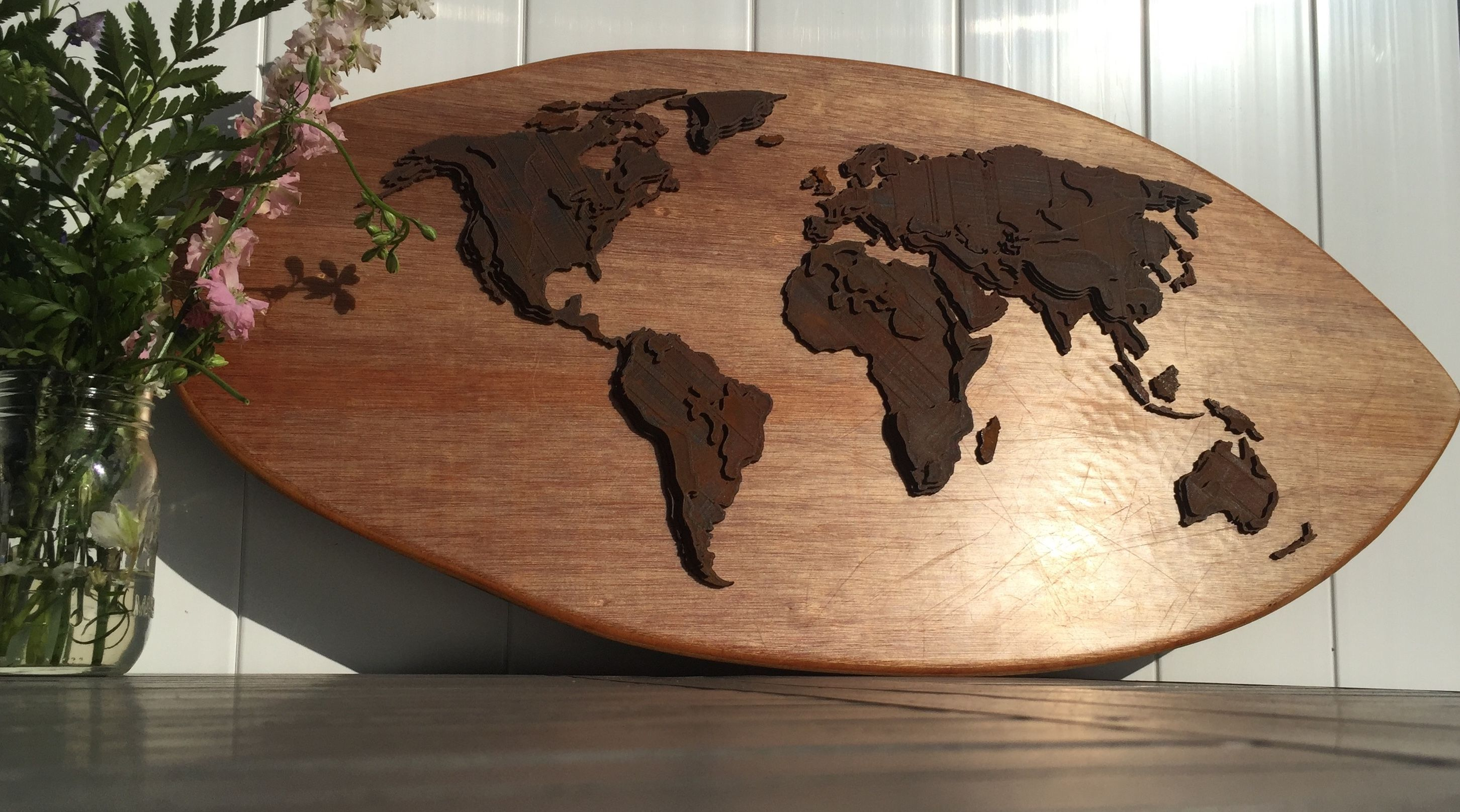 3d printed topographic map of the world mounted on a reclaimed