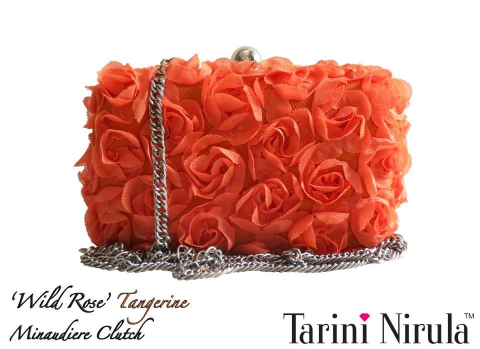'WILD ROSE' TANGERINE Minaudière  Inspired by the untamed beauty of ethereal roses, make heads turn with this delicate statement piece minaudiere, to be adorned with flawless style.Perfect for a summer brunch or an evening out with friends. Optional silver chain.Limited Edition piece.