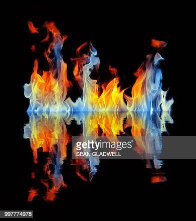 Blue and orange fire reflection on black background