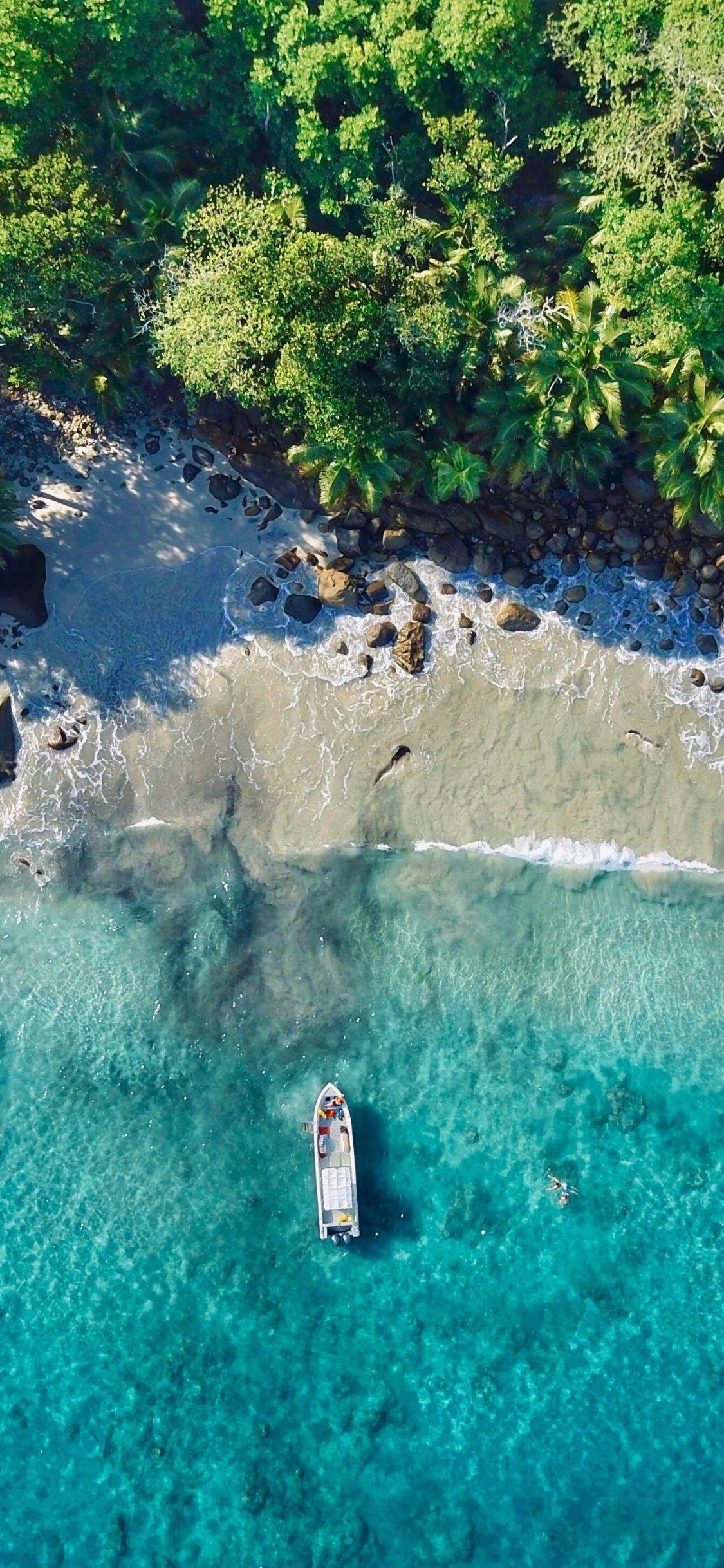 Beach Boat Blue Sea Rocks Aerial View 1125x2436 Wallpaper November Wallpaper Beach Wallpaper Iphone Wallpaper Ocean Wallpaper coast aerial view sea boat