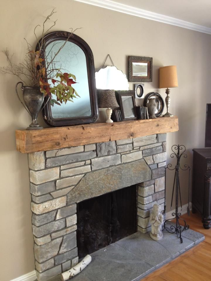 8x8 reclaimed wood beam makes a lovely mantel fire place for 8x8 living room ideas