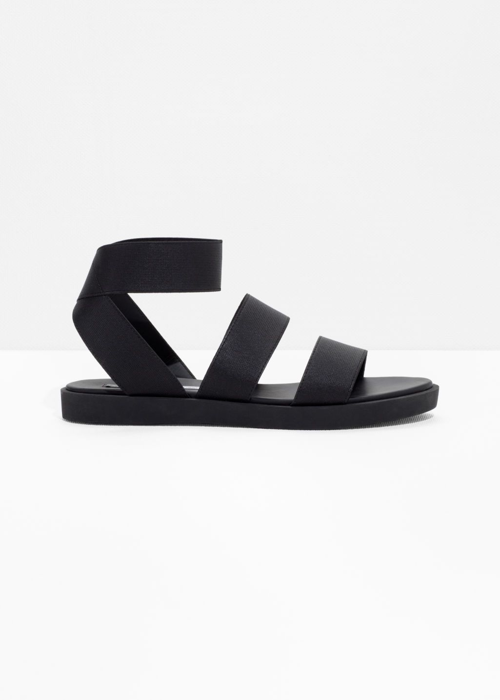 a98ad8e90 Front image of Stories elastic strap sandal in black
