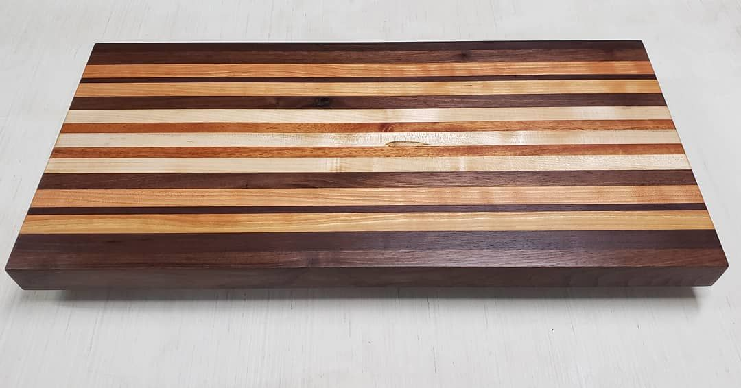 Completed custom butcher block board. This is a custom size and custom thickness board that will be installed on top of a dishwasher and flush mounted to the kitchen countertop. Sometimes Simple lines makes a big statement.  We used Walnut,  Cherry,  Hard Maple and some African Mahony as accent strips. . Dm us for orders.. .. #cuttingboard #decorating #interiordesign  #homedecor #cherry&nb