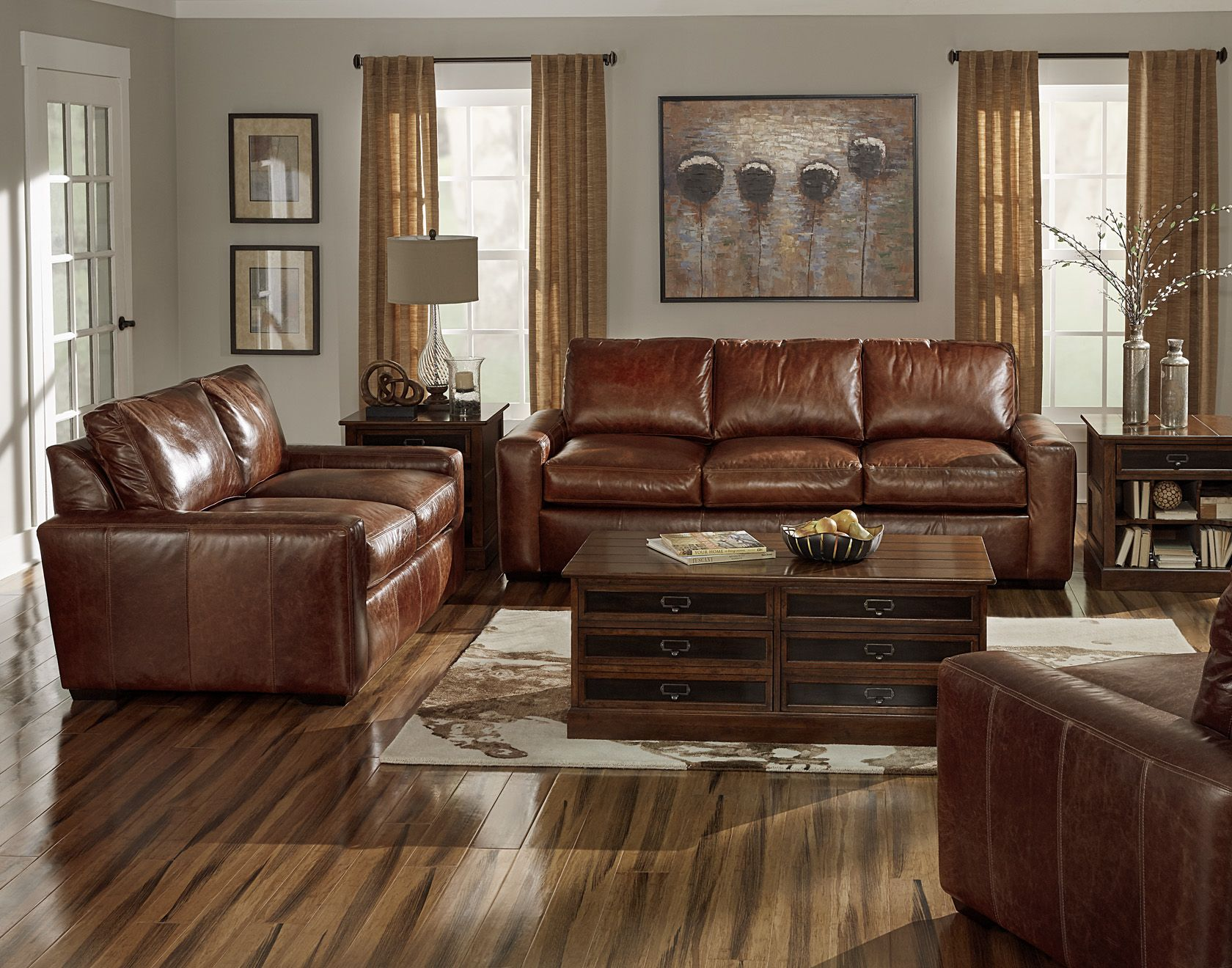Wide arms, deep seat, beautiful leather. This sofa set ...