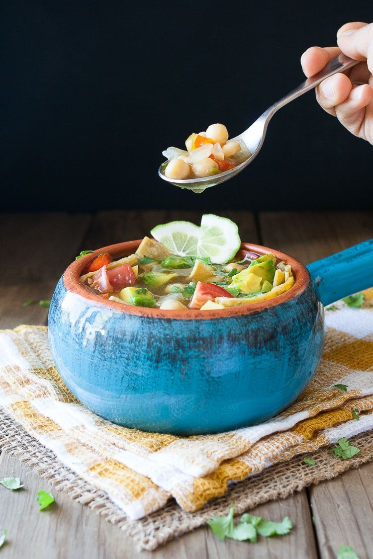 Tequila Lime Chickpea Soup. A flavor packed Mexican soup made with chickpeas, lime and tequila it's comforting, easy and delicious! | www.veggiesdontbite.com | #vegan #plantbased #glutenfree #spon #OrganicMoments #lecreusetlove