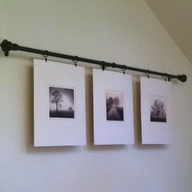 Hang Pictures From A Curtain Rod With Curtain Hooks Hanging Pictures Hanging Pictures On The Wall Curtain Rods