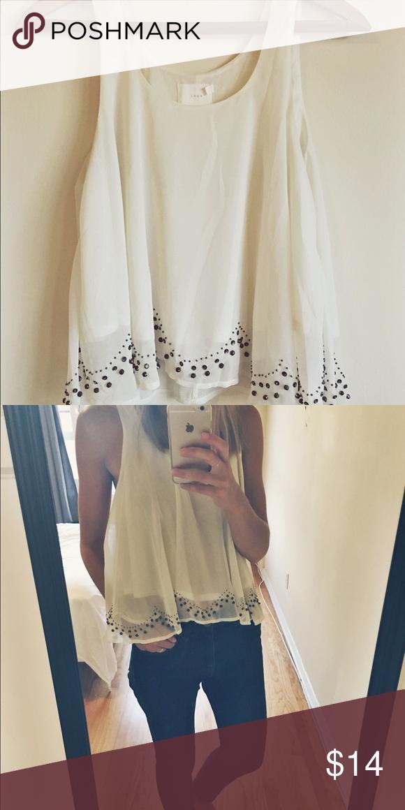 Flowy, beaded white sleeveless top Lush brand beaded white sleeveless blouse. Size small. Lush Tops Tank Tops