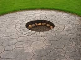 Silver Stamped Concrete Patio Area With Fire Pit