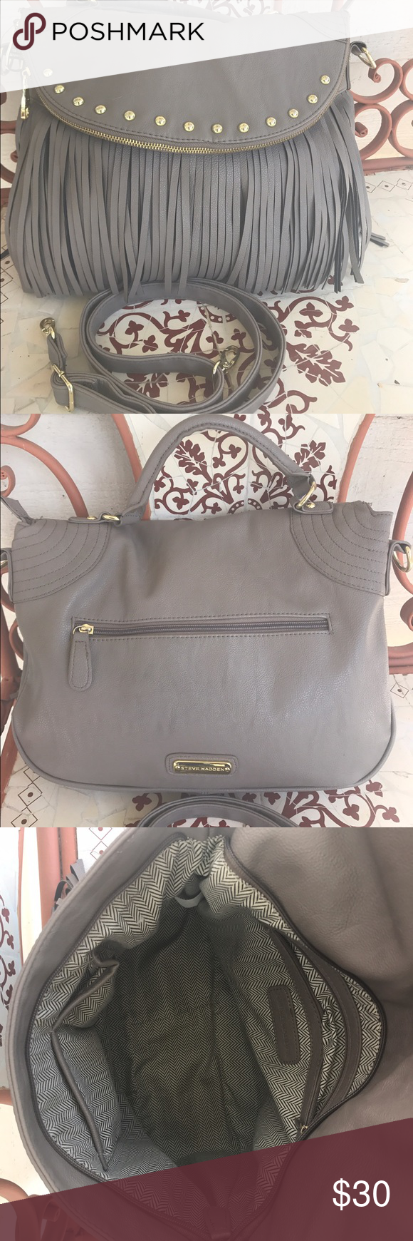 """Steve Madden Purse Steve Madden Purse, removable crossbody strap(adjustable). Length is 16"""", width 4"""", & depth is 10"""". Taupe color with black/taupe fringe! Steve Madden Bags Crossbody Bags"""