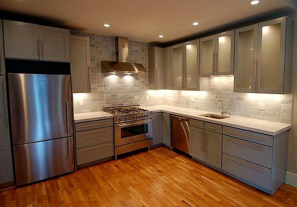 Stylish corner kitchen furniture    Corner furniture and a steel fridge, make for an elegant kitchen design – by Melissa Miranda Interior Design