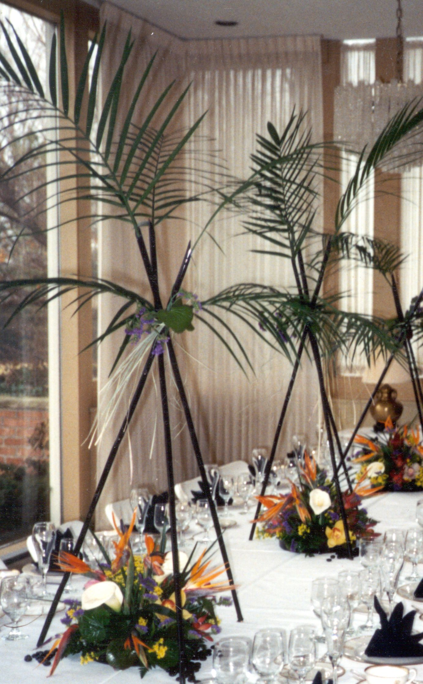 Tropical Arrangement Using Black Bamboo And Orchids Nylon Flowers