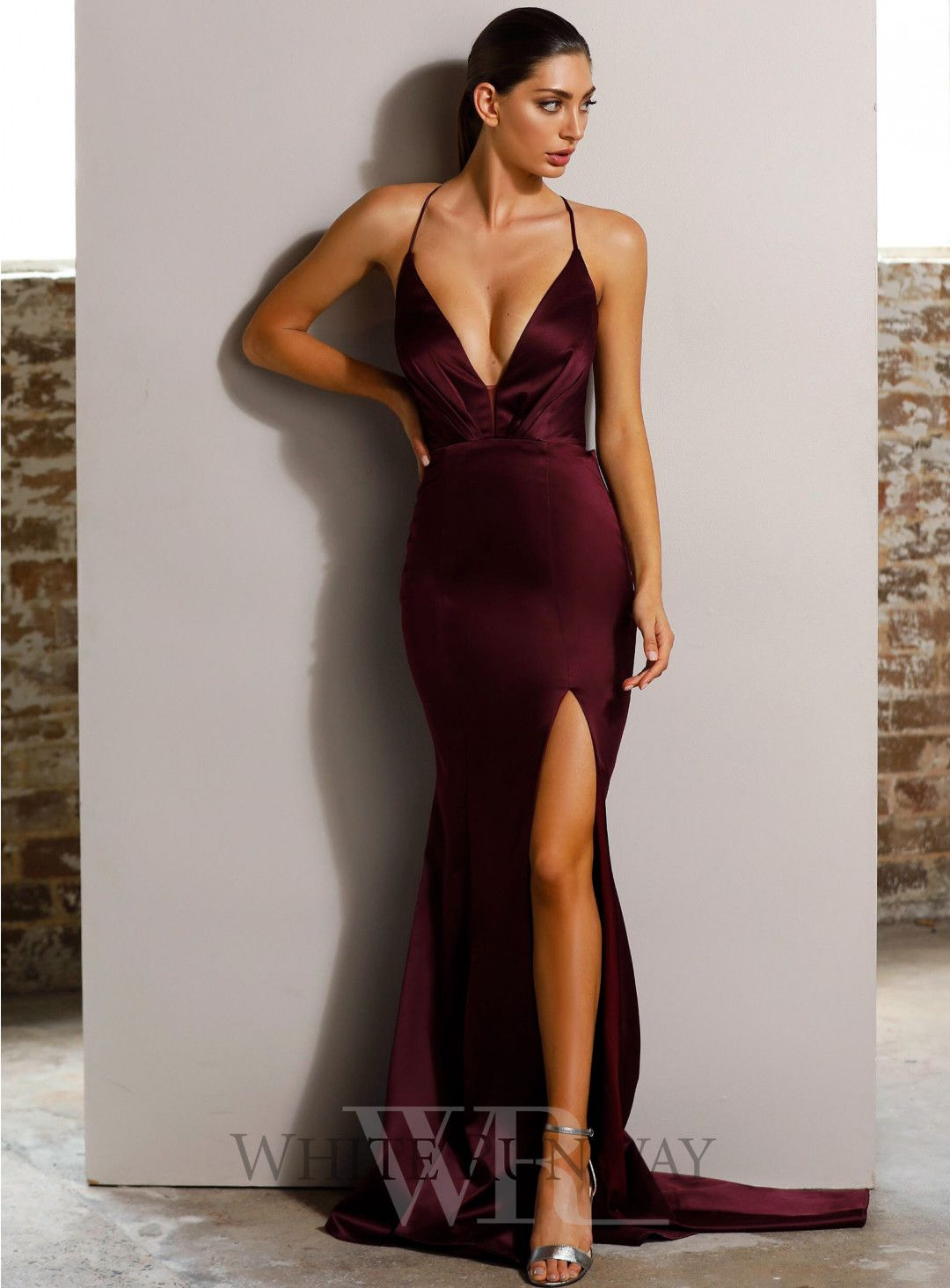 672e6ca637 A sexy full length gown by Jadore. A deep v-neck style featuring a low back  with criss-cross detailing and high leg split.  wedding  bride  bridesmaid   prom ...