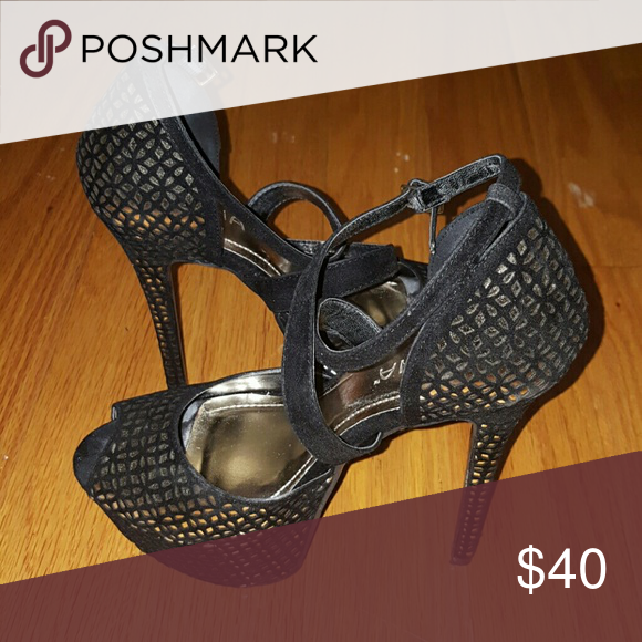 Stilettos Show your wild side with this Liliana Women's High Heel, Peep Toe Platform Sandal with Black and Gold Design. This heels also features a crisscross strappy vamp makes the shoe stand out and gives them a little edginess appeal. They will perfectly compliment any outfit for any occasion! Pair these with a black dress, body suit, or jeans. Make sure to add these to your collection, they definitely are a must have! Liliana Shoes Heels