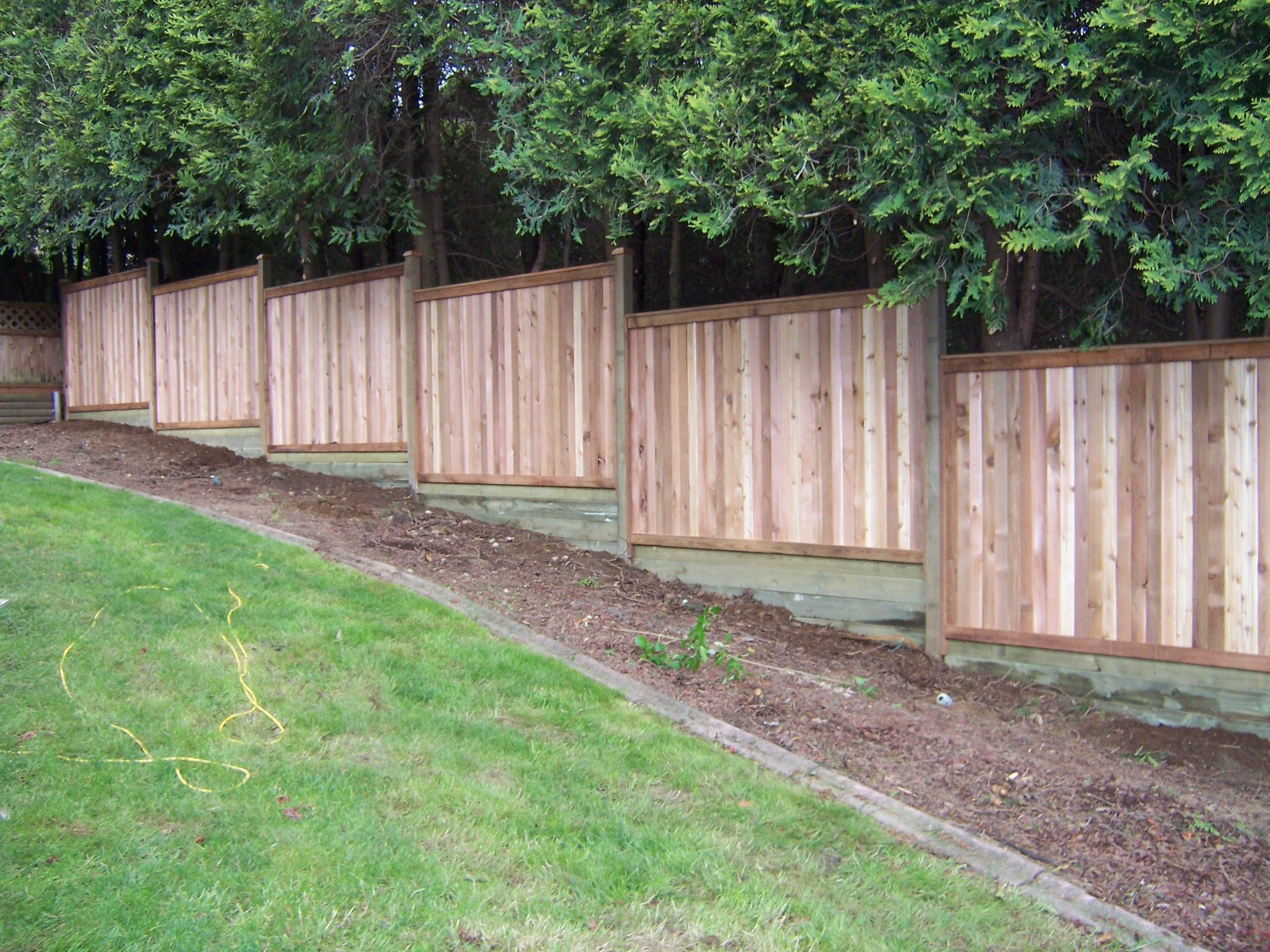 Ideas For Filling In Pre-fabbed Fence Sloping Grade | Sloped ... on drain backyard, slope backyard, city backyard, design backyard, sod backyard, level backyard,