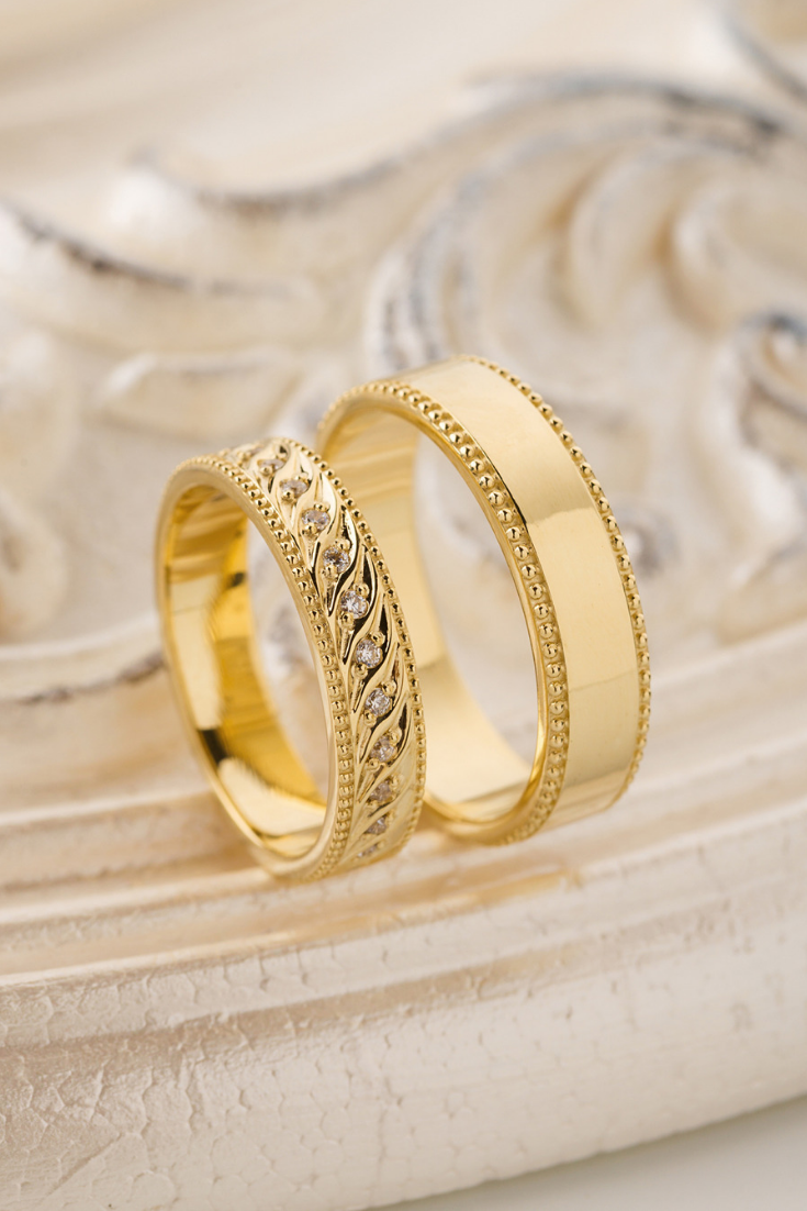 Gold wedding bands with milgrain details and diamonds. Wedding