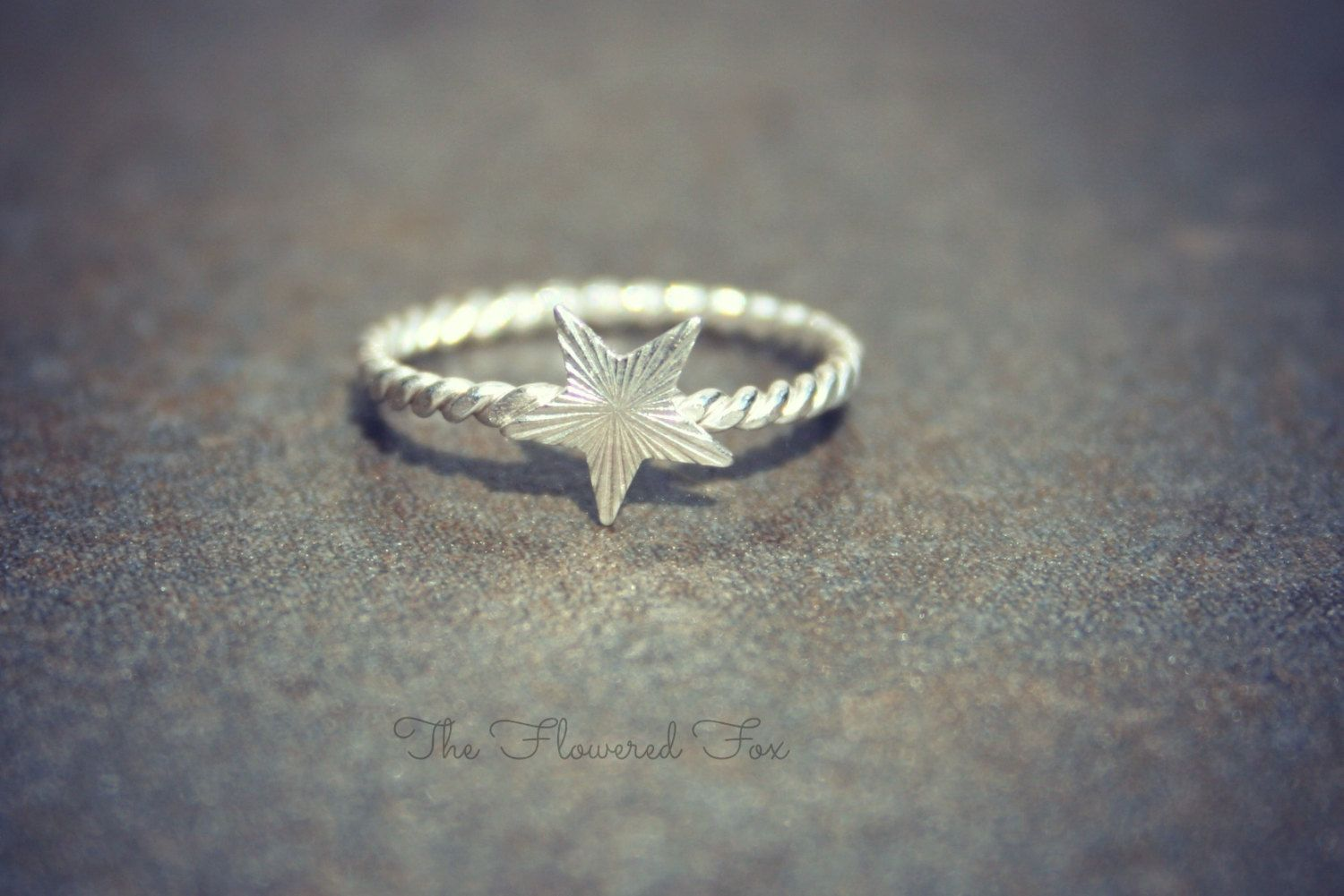 This sterling silver star midi ring is worn above the knuckle for a unique look. This ring is skinny and dainty measuring between one and two millimeters wide.  https://ravingruby.com/product/nautical-star-midi-ring/